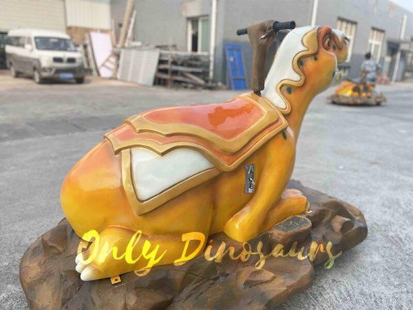 The Back of an Orange Cartoon Armor Dinosaur Ride