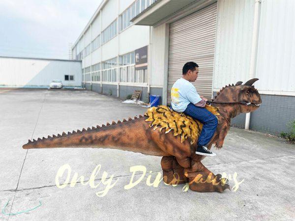 A Man Riding a Carnotaurus