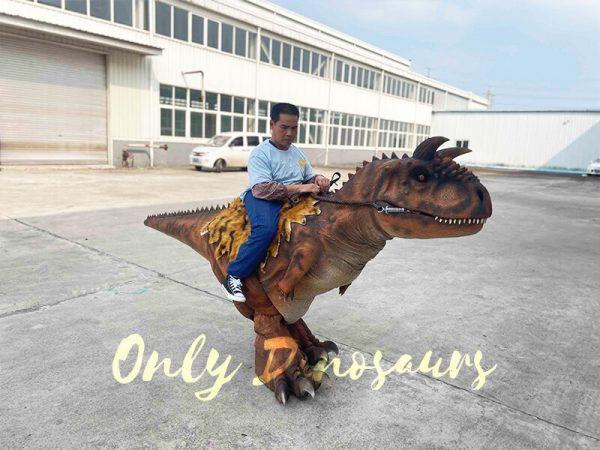A Man Riding a Ferocious Carnotaurus