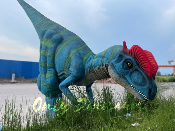 A Blue Dilophosaurus with Green Stripes and Red Crown