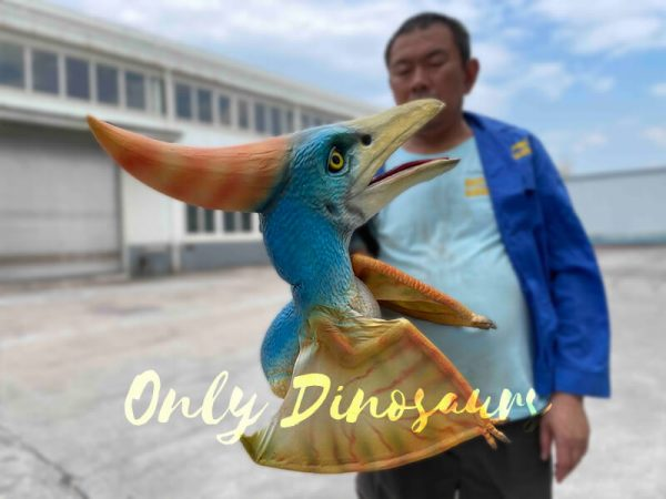 A Man carrying a Colorful Baby Pterosaur