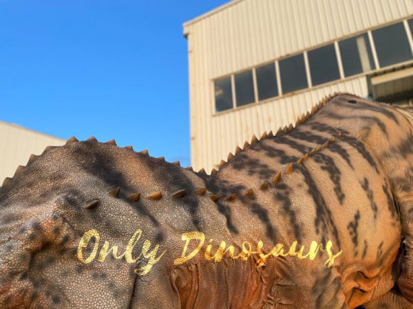 The Back of the Brown Giant T-Rex with Black Stripes