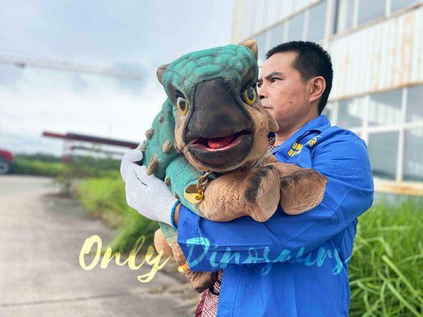 A Man Huging A Blue Baby Ankylosaur