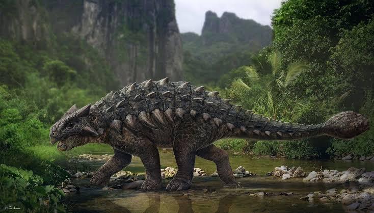 A Brown Ankylosaurus is Walking Through the Spring