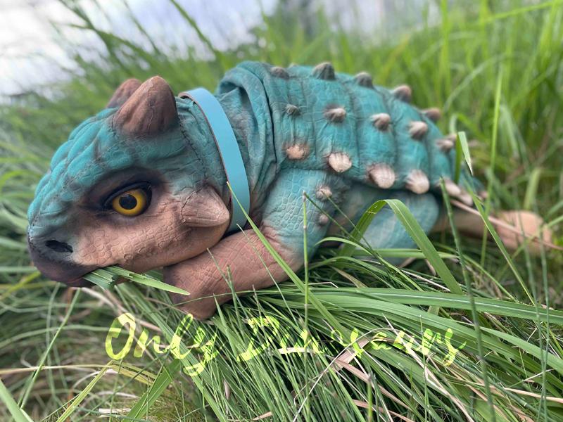 A Cute Blue Baby Ankylosaurus on the Glass