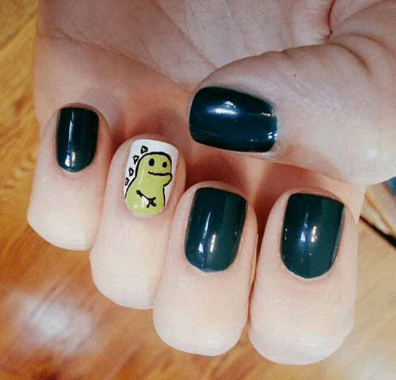 A Cute Yellow Dinosaur Nail with White Background and Three Black Nails