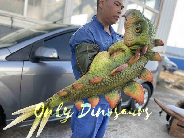 A man with a Parasaurolophus puppet