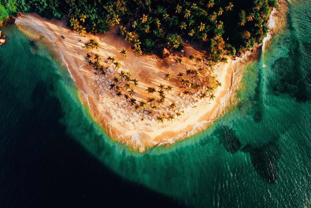 aerial photo of an island's beach and trees