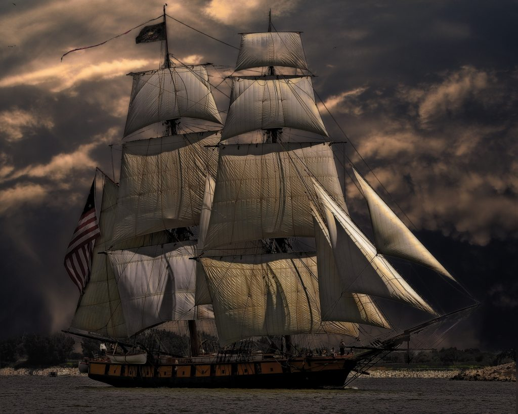illustration of a large wooden ship under overcast skies