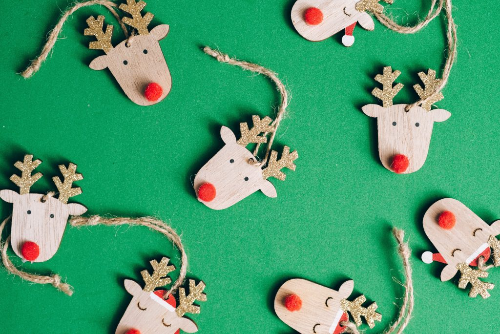 small reindeer Christmas decoration on a green background