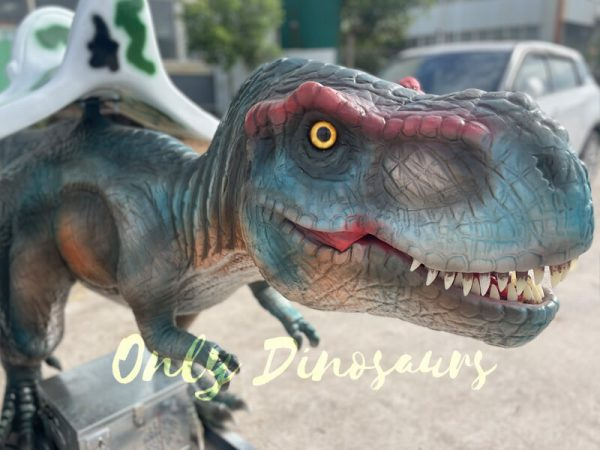 a colorful dinosaur ride on the ground