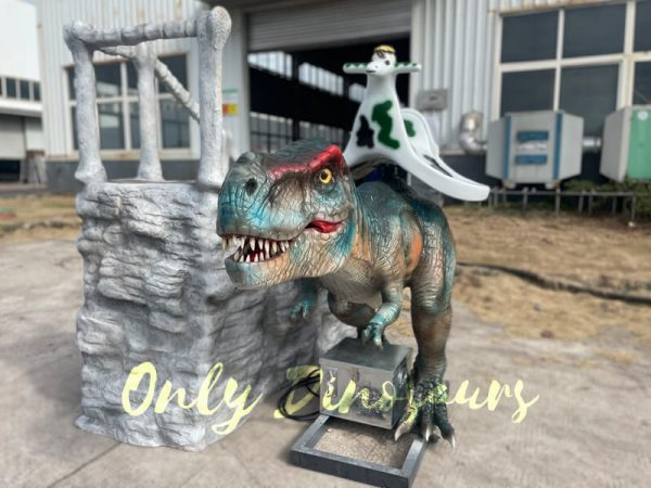 a colorful dinosaur ride with a figerglass ladder on the ground