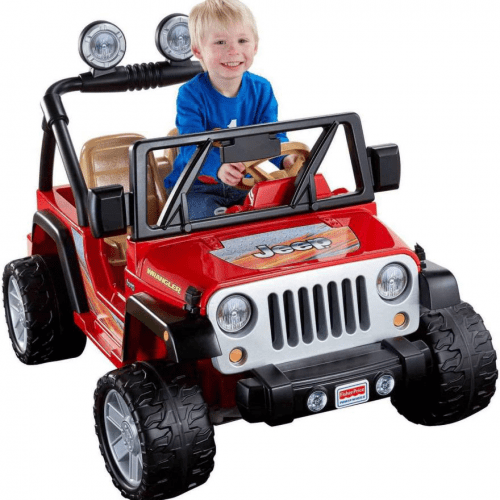 electric-rides-for-kids-a-young-boy-sitting-on-a-red-and-black-Jeep-for-kids
