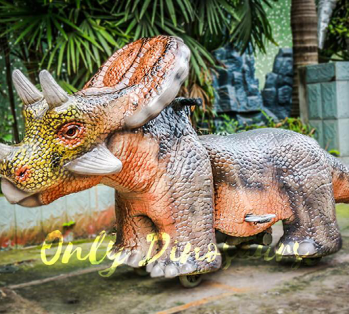 electric-rides-for-kids-an-orange-gray-Triceratops-scooter-facing-left
