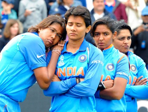 India players stand dejected prior to receiving their runners-up medals after losing the ICC Women's World Cup final match against England, at Lord's, in London, Sunday, July 23, 2017. (AP Photo/Rui Vieira)