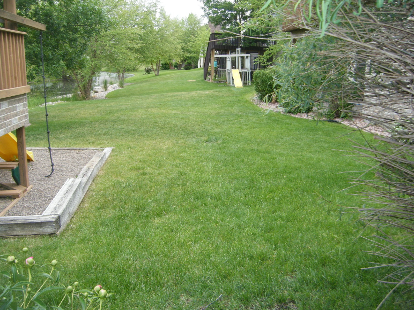 Kids and dogs love to run in long yards like the one at this home for sale at 18148 87th Pl
