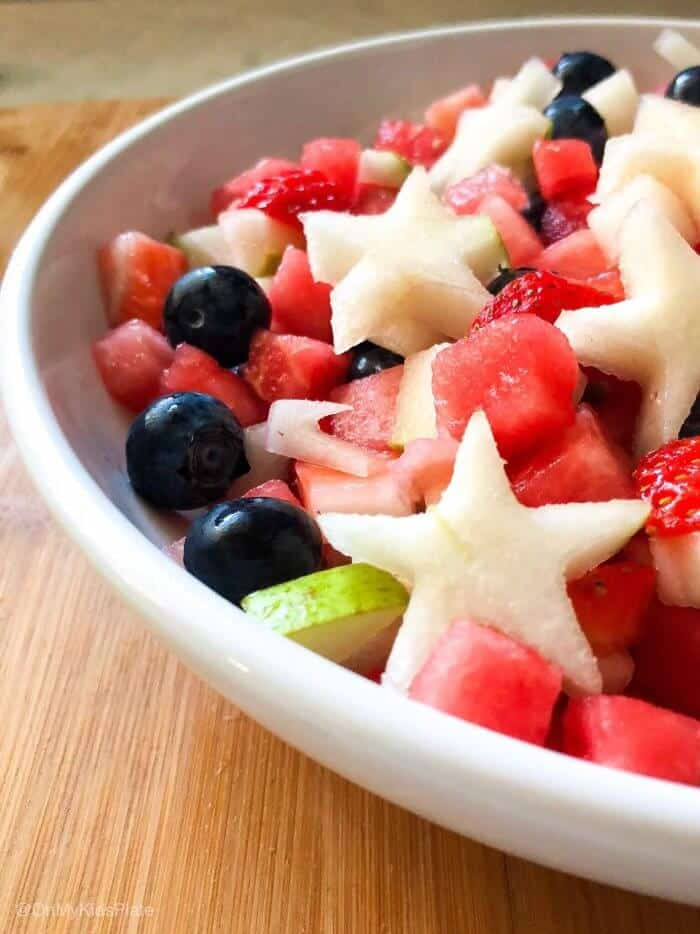 A bowl of fruit salsa topped with pear stars