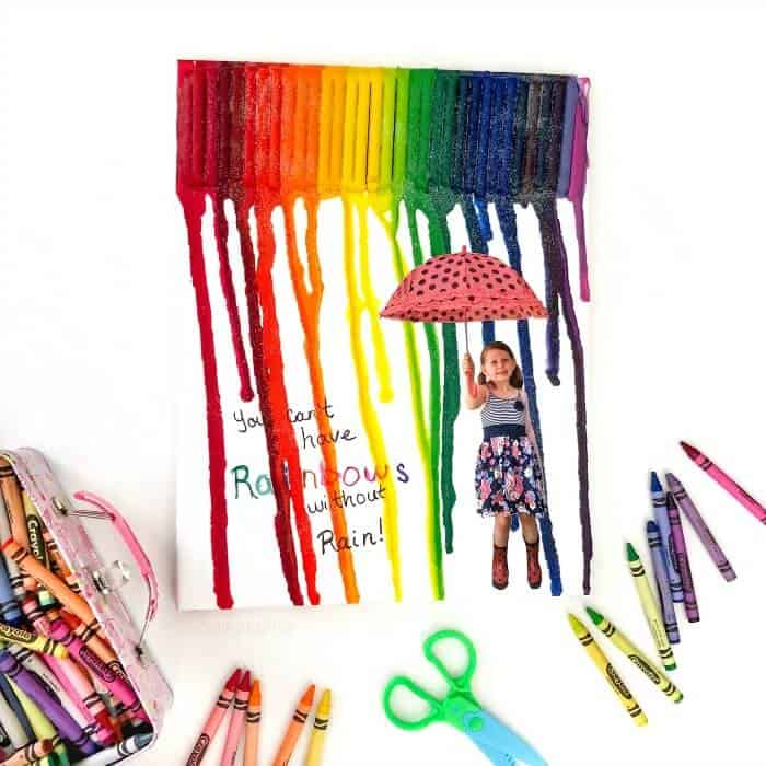Child's melted crayon art melting over a picture of a child holding an unbrella