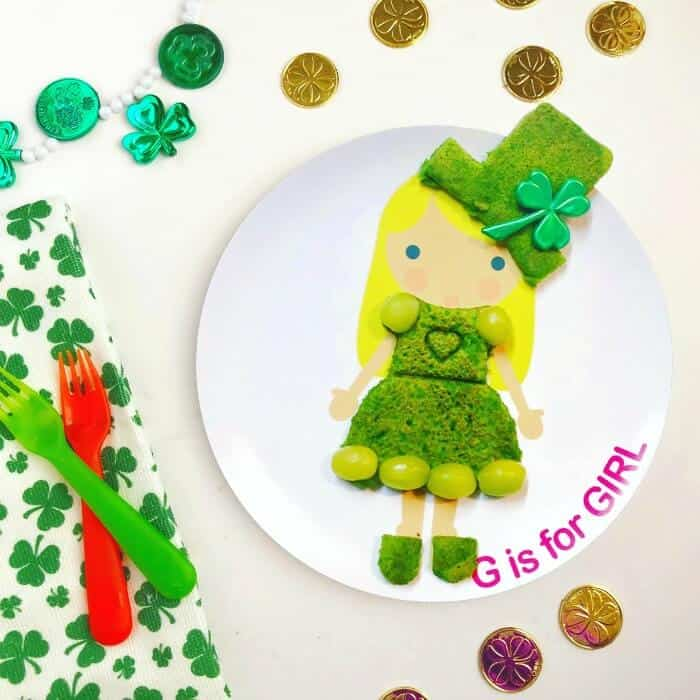 A child\'s plate decorated with green food to look like a leprechaun