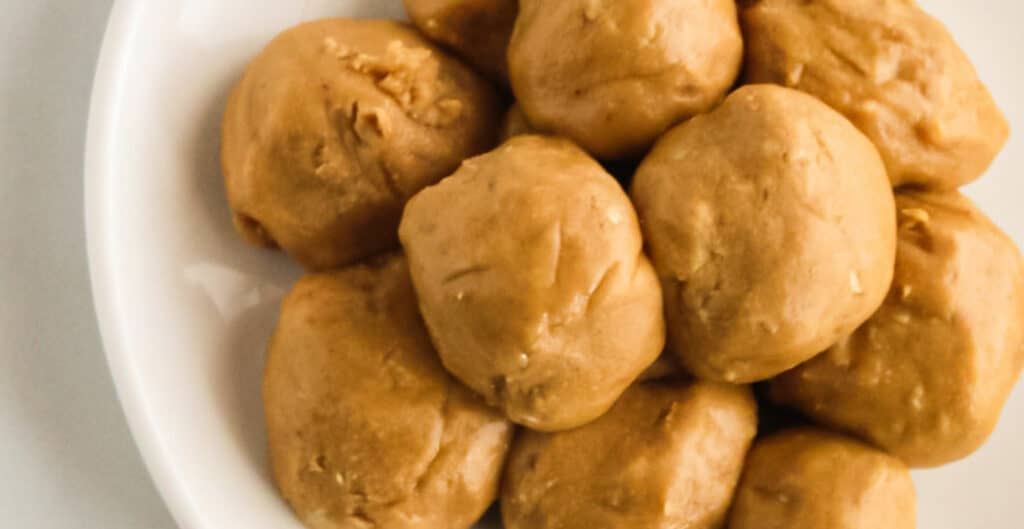 peanut butter snack bites piled on a plate from overhead
