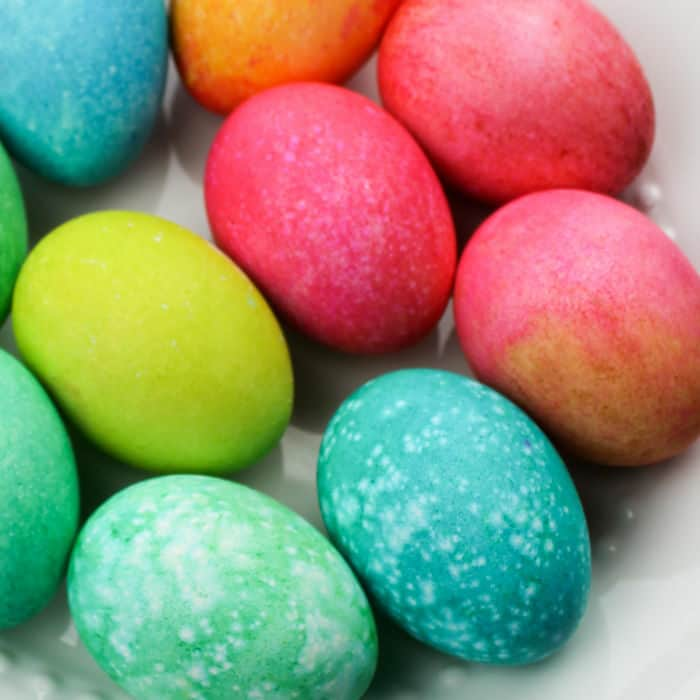 A pile of colorful easter eggs