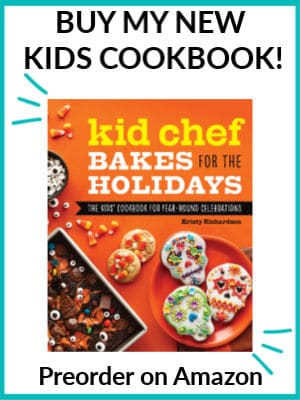 The cover of Kid Chef Bakes For The Holidays with a text title overlay that says Buy my Kids Cookbook, preorder on amazon.
