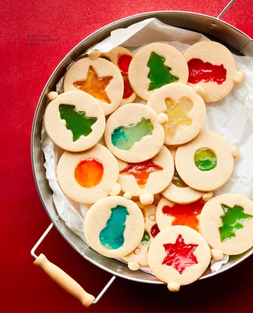 Christmas ornament shaped stained glass cookies on a serving plate