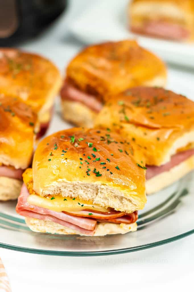 Platter of melty ham and cheese sliders