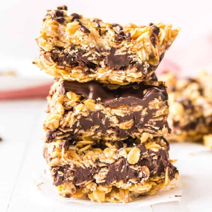 Stack of chocolate oatmeal bars three tall from the side.