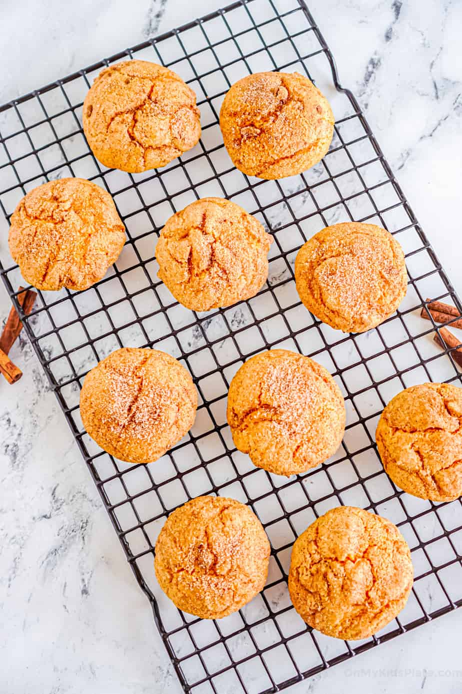 Pumpkin snickerdoodle cookies cooling on a wire rack