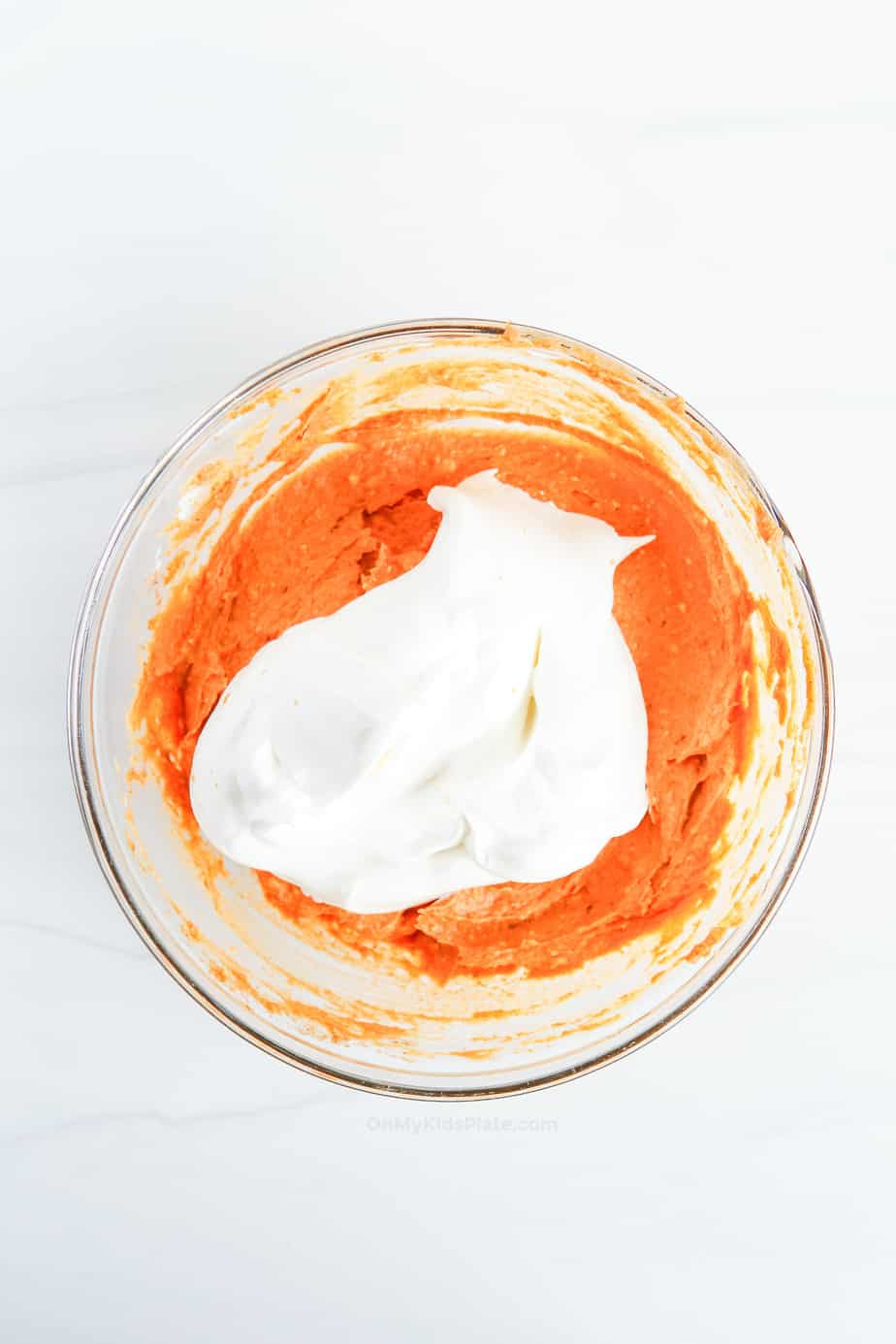 Adding whipped topping and mixing in to the pumpkin dip