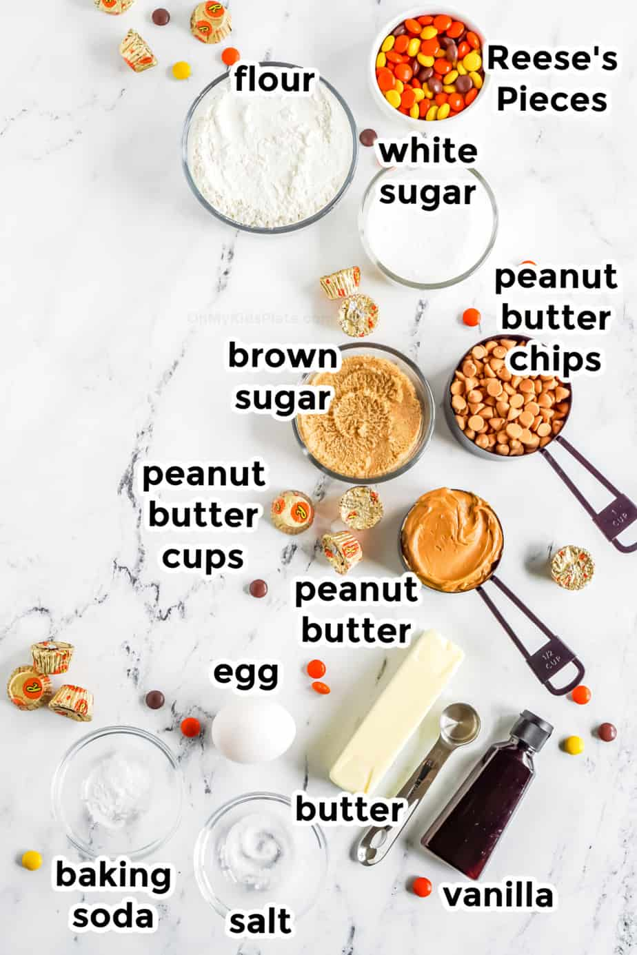 Ingredients in bowls for Reese's Pieces Peanut Butter Chip Cookies from above labeled.