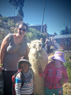 These adorable and entrepreneurial children were charging 2 Bolivianos EACH for a photo of them with this llama.