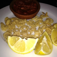 Calamari on one side of the plate, sliced hog rectums on the other.  Which is which?