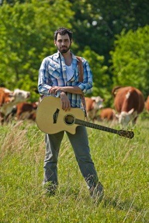 Lyal Strickland and some of his herd of grassfed herefords