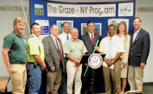 Graze-NY supporters and staff with Congressman Michael Arcuri at the press conference announcing the $400,000 in funding for the Graze-NY Program.  Left to right are Scott Fichbohm,Bill Paddock, Craig Schutt, Fred Griffen, Troy Bishopp, Congressman Arcuri, Kevin Lewis, Amanda Barber, and Ben Simons