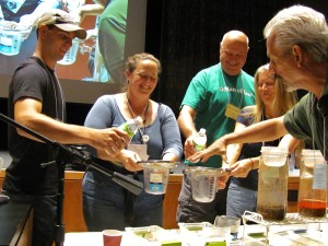 Participants work with Ray on a soil erosion demonstration