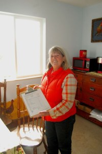 Renee Kreinbring welcomes customers into the small office with an intake form, hot coffee, & a warm smile.
