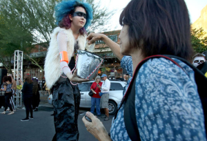 """This is a """"Hungry Ghost"""" one of many volunteers collecting donations along the route. For more pictures of the event, click and head to the Arizona Daily Star's gallery of photos."""