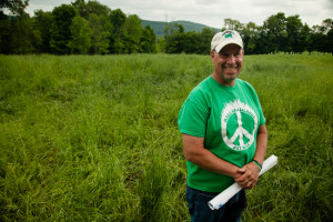 "Troy Bishopp stands on a rotationally-grazed farm operated by Karl Palmer in Madison County, Md., on May 28, 2015. ""We've helped with the water system here—fencing, some buffers and just overall pasture management,"" Bishopp said."
