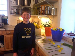 My nephew picked daffodils this spring, grouped them into bunches, and sold them himself at farmers market. Pretty good for a nine year old… that smile is NOT faked!