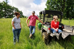 Ryan Collins, center, with NRCS staff Laura Crowell (left) and LuAnn Rolling (right). Photo: Jason Johnson, NRCS