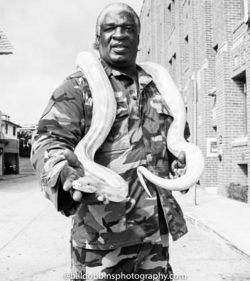 Man with snake on Venice Beach
