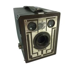 The Kodak Brownie and other box cameras came before the kind of Leica used by Cartier-Bresson. But these were snapshot cameras and not used by serious journalists.