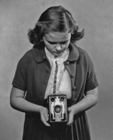 A girl taking a photograph with a Kodak box Brownie camera, circa 1935. (Photo by Keystone View Company/Archive Photos/Getty Images)