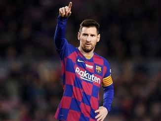 Messi stands