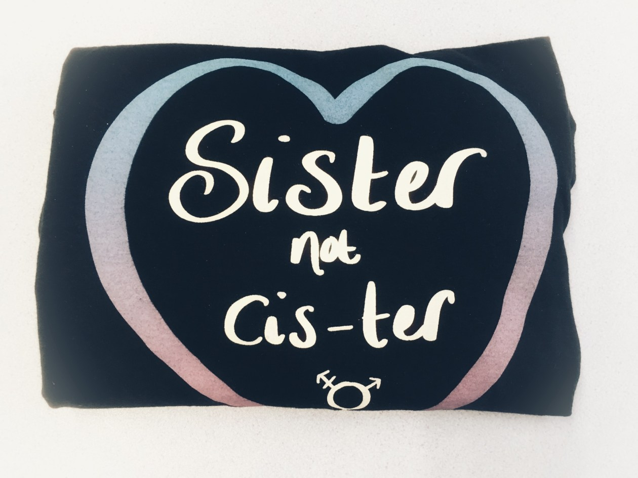 A 'Sister not 'cis-ter' trans inclusive feminist t-shirt. Photo.