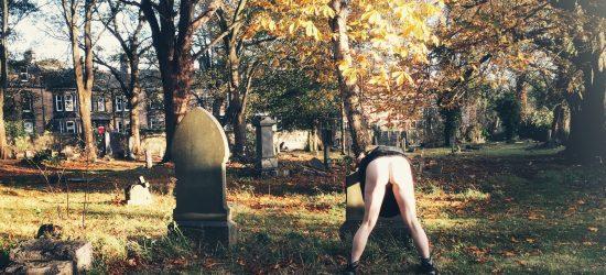 Naked in an autumn graveyard