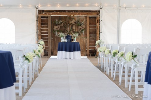 indoor ceremony setup under tent on sunny slope farm-10
