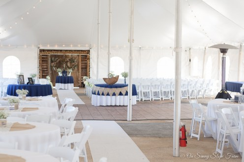 indoor ceremony setup under tent on sunny slope farm-5